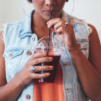 african-woman-drinking-juice-PHB3WQ5-scaled-350x350 Front Page