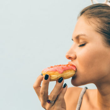 sexy-brunette-lady-eat-sweet-heart-shaped-donut-2HKLRBJ-scaled-350x350 Front Page